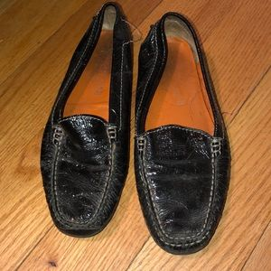 Black patent leather slip on shoes